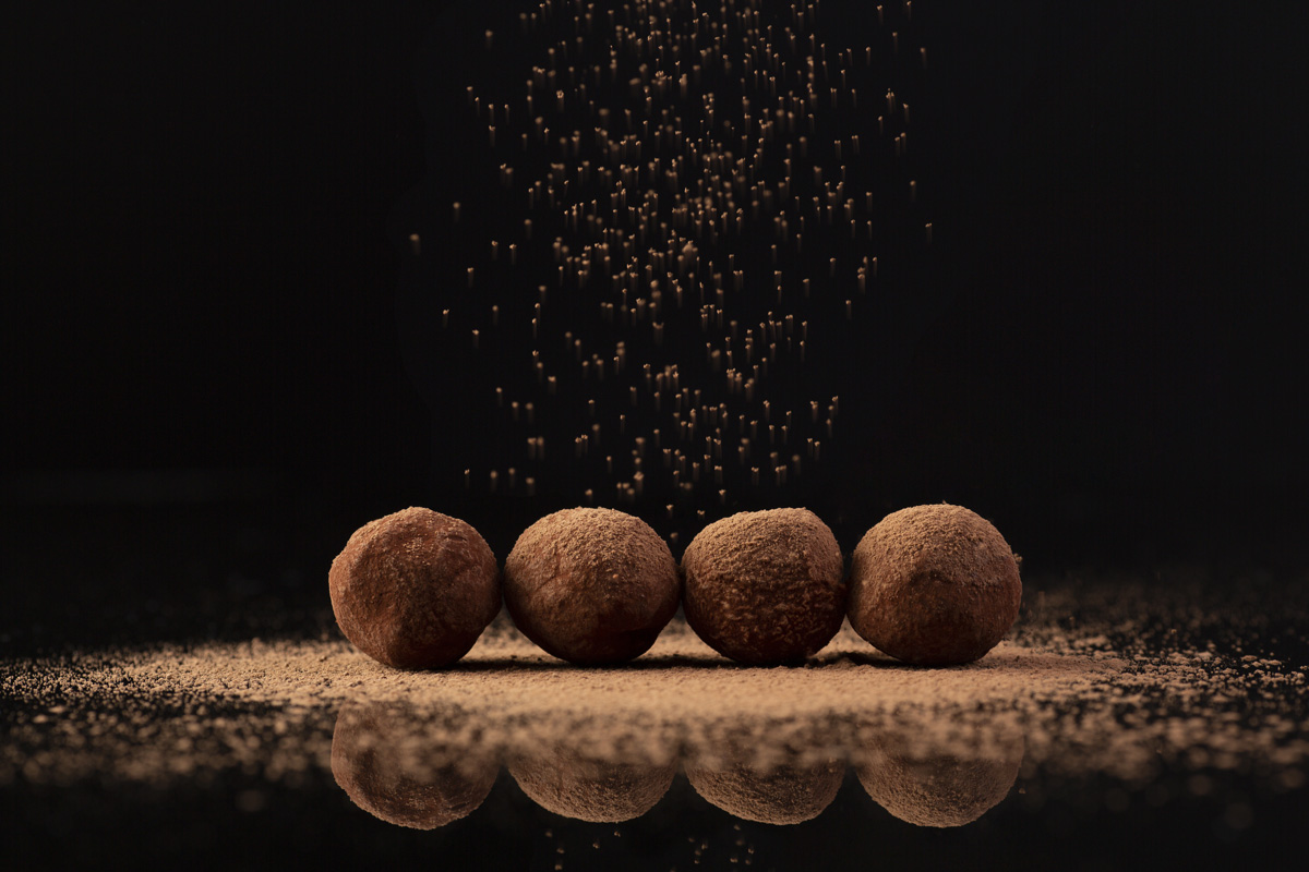 Chocolate truffles properly decorated with cocoa powder
